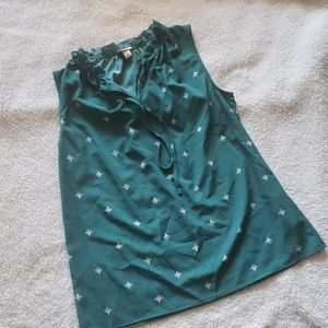 Green patterned sleeveless blouse